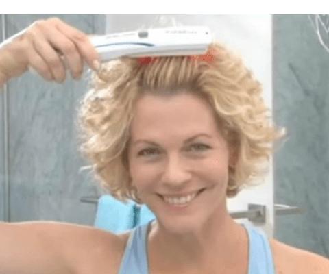 woman using hairmax laser comb